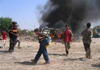 Roadside bomb explodes in Somali capital,two people killed,10 wounded