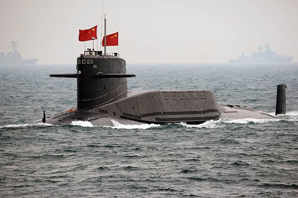 Chinese submarine attacks US aircraft carrier in naval drills. China imitates attack on USA