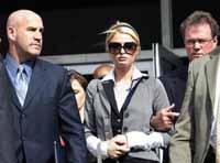 Authorities cut Paris Hilton's jail term to about 23 days