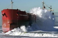 Salvage crews attempt to move beached freighter in Australia