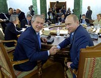 Amid tense ties, Bush and Putin ready for one-on-one meeting in Germany