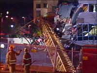 Construction crane bucket falls into mid-Manhattan building injuring 8 people