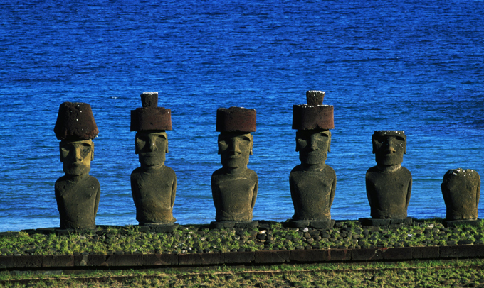 Easter Island: Eternally mysterious Easter Island is one of the most remote inhabited islands in the world. The large stone statues, or moai, for which Easter Island is famous, were carved in the period 1100–1680 CE (rectified radio-carbon dates). A total of 887 monolithic stone statues have been inventoried on the island and in museum collections. Although often identified as  Easter Island heads , the statues have torsos, most of them ending at the top of the thighs, although a small number are complete figures that kneel on bent knees with their hands over their stomachs. Some upright moai have become buried up to their necks by shifting soils easter_island