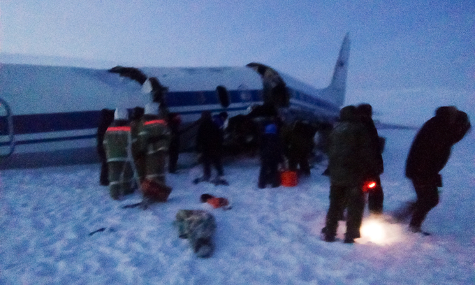 Last tragedies of 2016 A Russian military plane carrying combat pilots crash-landed Monday while approaching an Arctic airport, injuring most of the 39 people on board.an Il-18 turboprop, crash-landed near the town of Tiksi in the Sakha-Yakutia region on the Laptev Sea. The plane carrying 32 passengers and a seven-member crew was flying from Kansk in eastern Siberia, around 2,300 kilometers (1,430 miles) southwest of Tiksi. The plane broke up when it landed in the tundra, but didn t catch fire. No one was killed tragedies