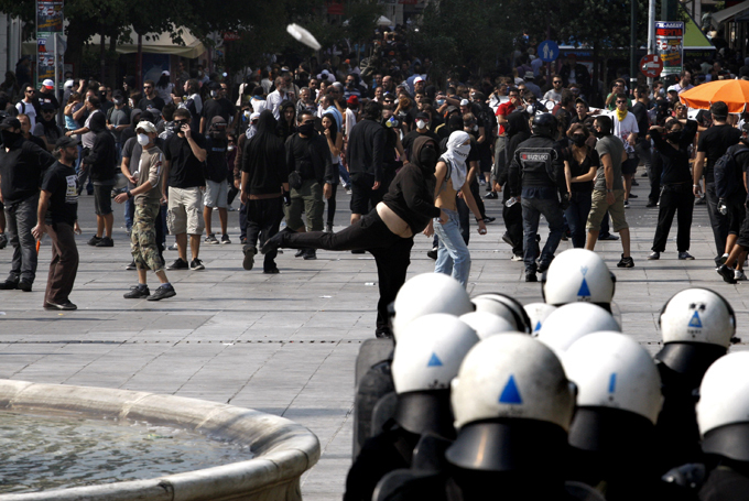 Greek police use tear gas against protesters A group of young people began throwing stones at the law enforcers and the police responded with tear gas. greece