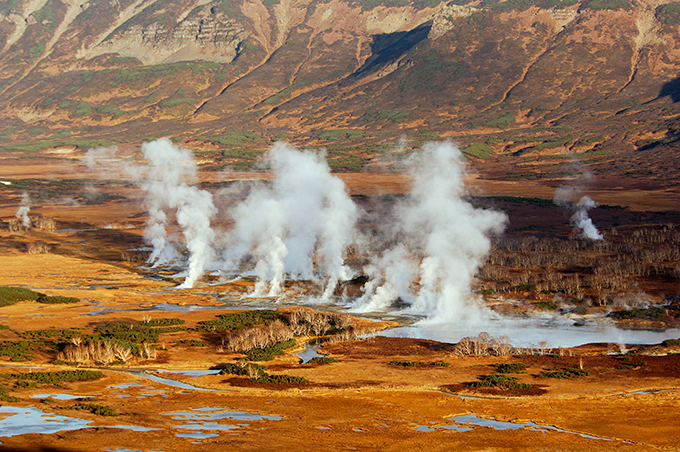 The Valley of Geysers in Russia s Kamchatka The Valley of Geysers (Russian: Долина гейзеров) is a geyser field on Kamchatka Peninsula, Russia, and has the second largest concentration of geysers in the world. This 6 km long basin with approximately ninety geysers and many hot springs is situated on the Kamchatka Peninsula in the Russian Far East, predominantly on the left bank of the ever-deepening Geysernaya River, into which geothermal waters flow from a relatively young stratovolcano, Kikhpinych. Temperatures have been found to be 250 °C, 500 m below the caldera ground. It is part of the Kronotsky Nature Reserve, which, in turn, is incorporated into the World Heritage Site  Volcanoes of Kamchatka . The valley is difficult to reach, with helicopters providing the only feasible means of transport.  All photos: Splash/All Over Press valley_geysers