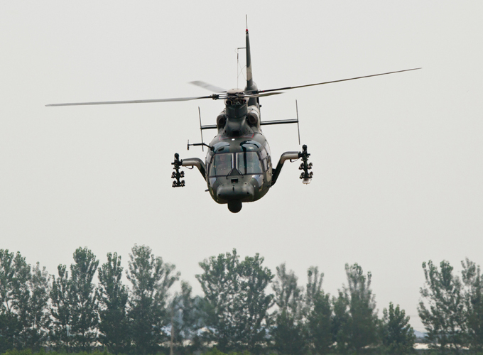 China unveils new attack helicopter The aircraft is used to transport astronauts back to base when they return to earth but there is now a focus on more combat-style training. china_helicopter