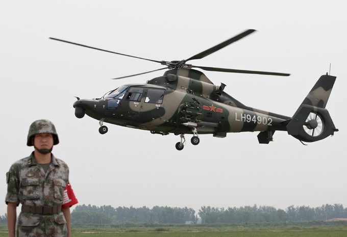 China unveils new attack helicopter China has conflicting claims with the Philippines, Vietnam, Brunei, Malaysia and Taiwan across the South China Sea, key shipping lanes thought to contain rich energy reserves. china_helicopter
