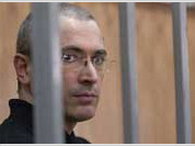 Yukos scandal continues with new raids and new charges to be brought against Mikhail Khodorkovsky