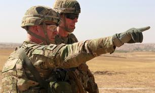 What for US deploys troops with artillery in Syria
