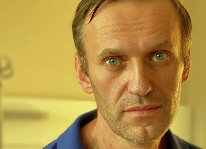 Alexei Navalny blames Putin, pledges to return to Russia
