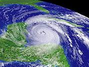 Wilma's power lashes Mexico, Florida to take weaker impact