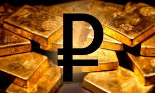 Russia amasses tons of gold as defense against US dollar