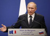 Putin annoyed by questions of his role in Russia in 2012
