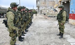 Putin arrives on Hmeymim airbase in Syria, orders withdrawal of Russian troops