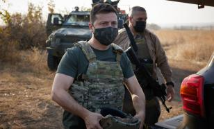 Ukraine's Zelensky, who did not serve in the army, visits Donbass