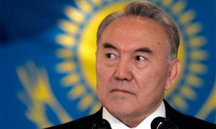 Kazakhstan's president doesn't threaten, but gives a warning