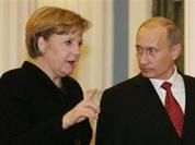 Putin stands firm in front of new German Chancellor Angela Merkel