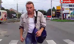 Aggressive passerby stops moving car with his angry look and iron fist. Video