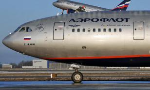 Russian footballer's wife withdrawn from flight for destructive behaviour