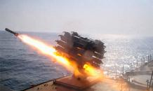Russian frigate tests missiles near NATO ship