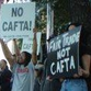 Bush signs controversial free trade deal into law