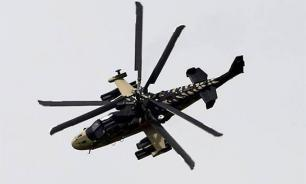 Ka-52 helicopter incidentally fires missiles at spectators during Zapad 2017 drills. Video