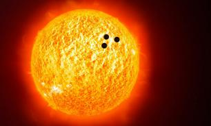 NASA spacecraft captures three huge UFOs silhouetted against the Sun