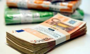 Euro declines after Merkel's victory