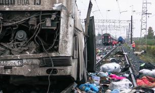 Train crashes into bus stuck on tracks in Russia, at least 19 killed