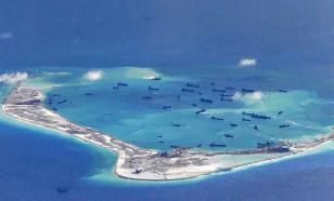 China shows its military might on disputed Spratly Islands
