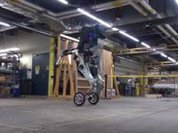 Amazing four-legged wheeled robot jumps over barriers. Video
