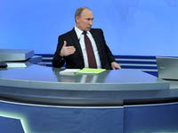 Putin praises political events in Russia and mocks McCain
