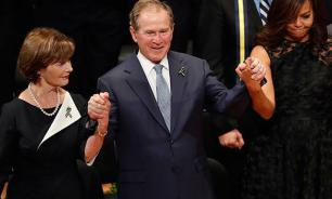 George W. Bush dancing and feeling good at Dallas police funeral ceremony. Video