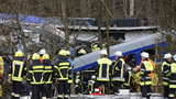 Two commuter trains crashed head-on Tuesday morning in a remote area in southern Germany, killing at least nine people and injuring some 150, some of whom had to be cut out of the wreckage and transported across a river for medical care. The two  trains crashed on the single line that runs near Bad Aibling, in Bavaria. Several wagons overturned. Fifty of those hurt have serious injuries