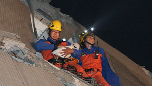 Rescuers on Sunday found signs of life within the remains of a high-rise residential building that collapsed in a powerful, shallow earthquake in southern Taiwan that killed over a dozen people and injured hundreds. Two survivors — one found shielded under the body of her husband — were pulled out alive from a toppled high-rise apartment building on Monday, two days after a powerful quake that killed at least 36