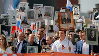 More than 700,000 people took part in the Immortal Regiment March in Moscow on May 9, 2016. President Putin joined the march as well. The march is a tradition to remember those, who gave their lives for peace in the struggle against Nazism. Every member of the march brings a photo of their relatives, who were either killed or participated in the Great Patriotic War. President Putin brought the photo of his father. Immortal Regiment marches took place in many other Russian cities nationwide. In total, 24 million people took part in the march on May 9, 2016