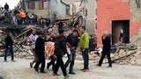 At least 21 people were killed and many others were trapped under rubble after a powerful earthquake struck central Italy