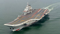 Liaoning is the first aircraft carrier commissioned into the People s Liberation Army Navy Surface Force. It is classified as a training ship, intended to allow the Navy to practice with carrier usage.