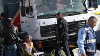 A Palestinian truck driver rammed his vehicle into a crowd of Israeli soldiers at a popular Jerusalem tourist spot Sunday, killing four people and wounding 17 others in the deadliest single attack of more than a year of Israeli-Palestinian violence. The attack came at a time of heightened tensions in Jerusalem, where Palestinians have warned of dire consequences if incoming President Donald Trump follows through on his promise to move the U.S. Embassy to the city