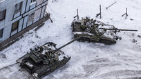 Ukrainian tanks stand in the yard of an apartment block in Avdiivka, eastern Ukraine, Wednesday, Feb. 1, 2017. Heavy fighting around government-held Avdiivka, just north of the militia-stronghold city of Donetsk erupted when Ukrainian forces went on an offensive. Russian President Vladimir Putin accused Ukraine of starting the escalation to rally support from the new U.S. administration and other Western powers