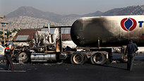 A natural gas tanker truck lost control, hit a center divider and exploded on a highway lined by homes in the Mexico City suburb of Ecatepec early Tuesday, killing at least 22 people and injuring nearly three dozen, The AP reports