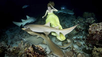 Woman in yellow dancing with sharks
