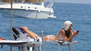 Helena Christensen enjoys the beach in Italy