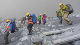 Rescuers continue to find more bodies  near the peak of Mount Ontake in central Japan Wednesday, Oct. 1, 2014. Search efforts for people missing since Saturday s surprise eruption resumed Wednesday morning