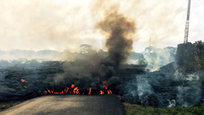 Hawaii authorities on Saturday told several dozen residents near the active lava flow to prepare for a possible evacuation in the next three to five days as molten rock oozed across the country road and edged closer to homes.