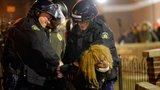 Missouri s governor ordered hundreds more state militia into the St. Louis suburb, Ferguson, Tuesday after a night of protests and rioting over a grand jury decision s not to indict police officer Darren Wilson in the killing of Michael Brown, a case that has inflamed racial tensions in the U.S. Protesters vandalize police vehicles, stores and burn a U.S. flag
