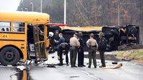 Two school buses collide in Tennessee, USA, killing one adult and two children. Over 20 others were injured.