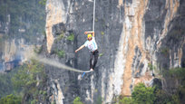 Alexander Schulz from Germany managed to break the Guinness World Record for the longest distance walked on a highline in Guilin, Guangxi, where he spent days crossing a 375-meter-long rope while balancing 100 meters above ground (All photos: Splash/All Over Press)