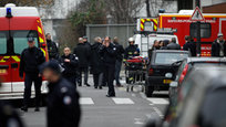 At least 12 people were killed and four critically injured after masked gunmen stormed the Paris office of French satirical newspaper Charlie Hebdo in what French officials are calling a terror attack